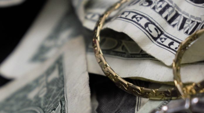 Pound Drops to 2 Week Low vs. Dollar